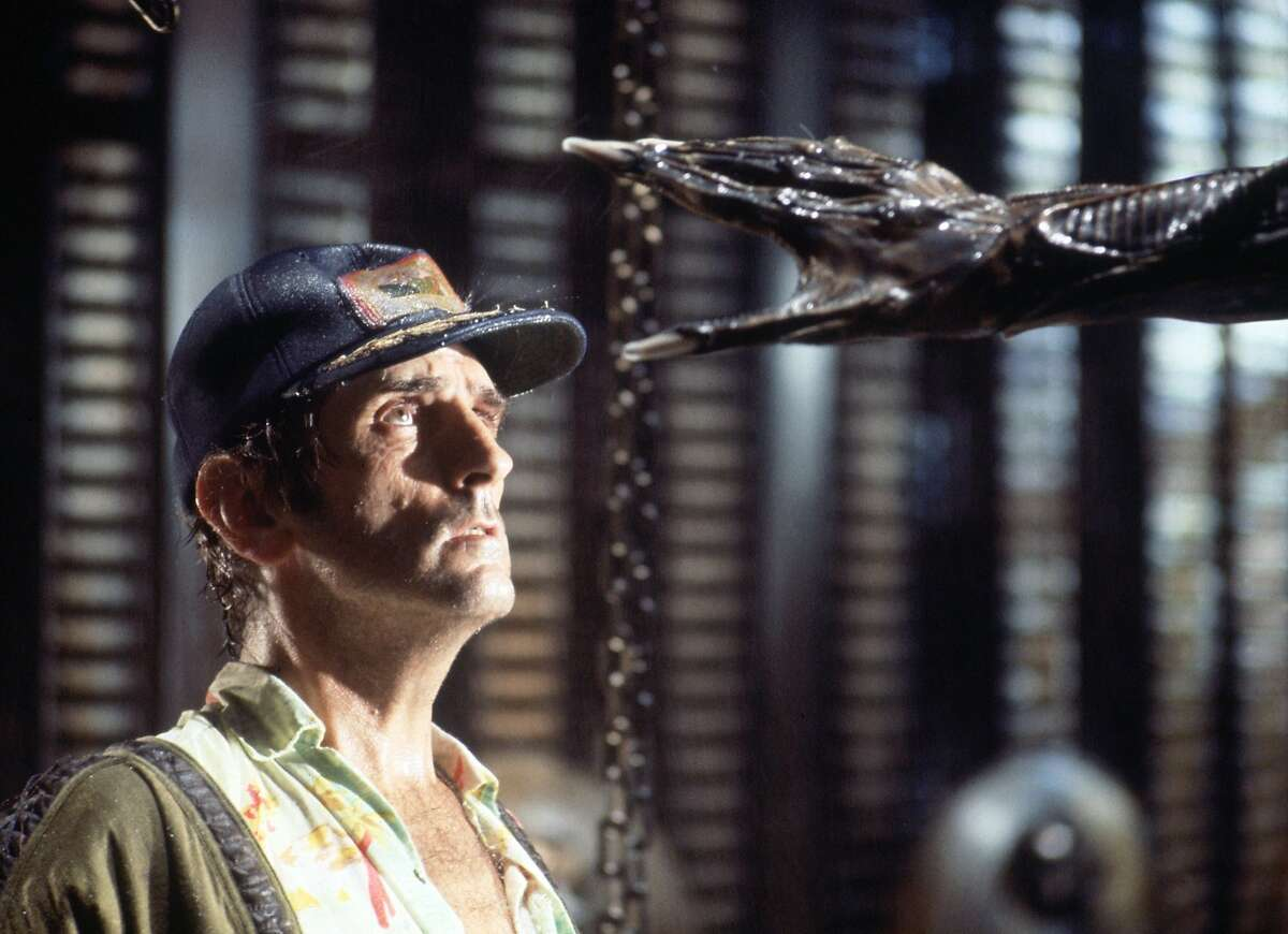 """Actor Harry Dean Stanton faces an alien creature in a scene from the 1979 sci-fi-horror film """"Alien,"""" in this undated promotional photo. Director Ridley Scott has restored the film digitally, improved the audio, trimmed some small transitions and brought back about five minutes of deleted footage. """"Alien: The Director's Cut,"""" hits theaters Oct. 29, 2003. (AP Photo/Robert Penn, Twentieth Century Fox)"""