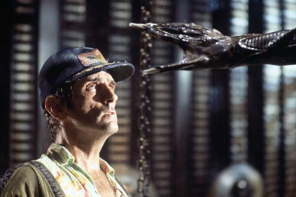 "Actor Harry Dean Stanton faces an alien creature in a scene from the 1979 sci-fi-horror film ""Alien,"" in this undated promotional photo. Director Ridley Scott has restored the film digitally, improved the audio, trimmed some small transitions and brought back about five minutes of deleted footage. ""Alien: The Director's Cut,"" hits theaters Oct. 29, 2003. (AP Photo/Robert Penn, Twentieth Century Fox)"