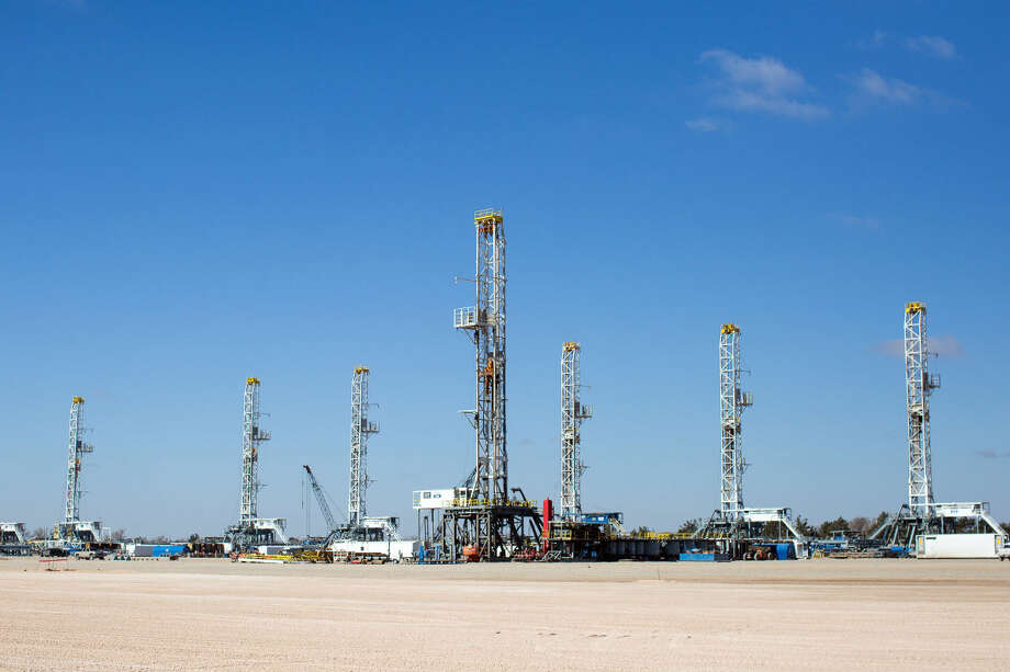 As rig counts drop in the Permian Basin, oil drilling rigs idle in Helmerich & Payne International Drilling Company's yard in Odessa, Texas, Thursday, Jan. 15, 2015. (AP Photo/Odessa American, Courtney Sacco)