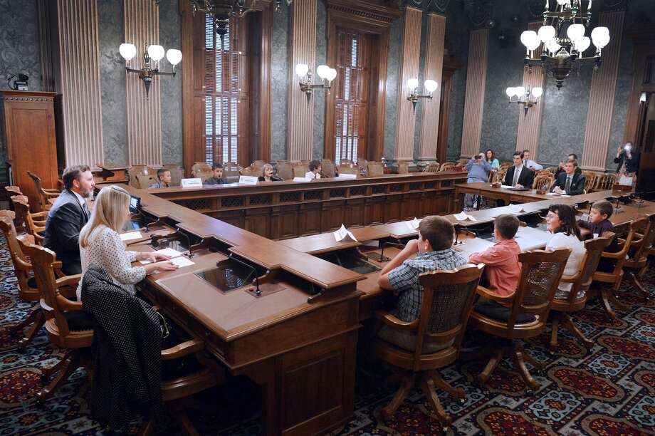 """Sen. Phil Pavlov, R-St. Clair Township, sits in a Senate hearing room with some of the winners of the 2016 Be a Senator For a Day summer reading contest. The """"junior senators"""" traveled to Lansing with their parents to participate in a mock swearing-in ceremony and committee hearing and a guided Capitol tour. (Submitted Photo)"""
