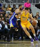 LAS VEGAS, NV - OCTOBER 15:  Ivica Zubac #40 of the Los Angeles Lakers is guarded by JaVale McGee #1 of the Golden State Warriors during their preseason game at T-Mobile Arena on October 15, 2016 in Las Vegas, Nevada. Golden State won 112-107. NOTE TO USER: User expressly acknowledges and agrees that, by downloading and or using this photograph, User is consenting to the terms and conditions of the Getty Images License Agreement.  (Photo by Ethan Miller/Getty Images)