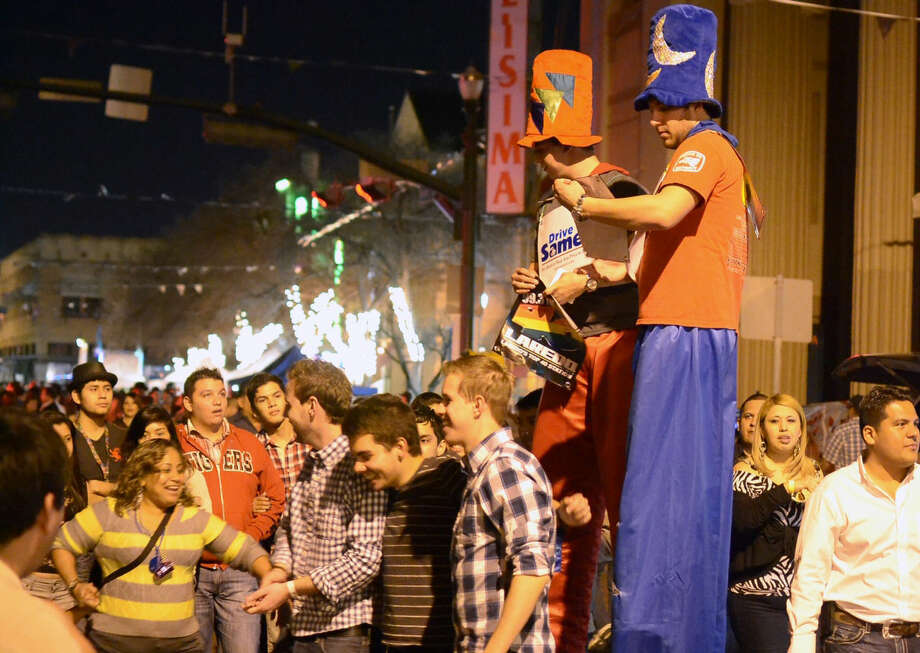 In this January 2013 file photo, street performers on Flores Street dazzle attendees of the UETA Jamboozie in downtown Laredo. (Photo by Laredo Morning Times)