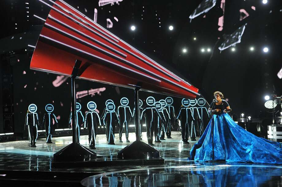 Above: Marisol Hernandez of La Santa Cecilia performs at the Latin American Music Awards in Los Angeles. At right: La Santa Cecilia members Alex Bendana, left, Marisol Hernandez, Jose Carlos and Miguel Ramirez. Photo: Vince Bucci, Associated Press