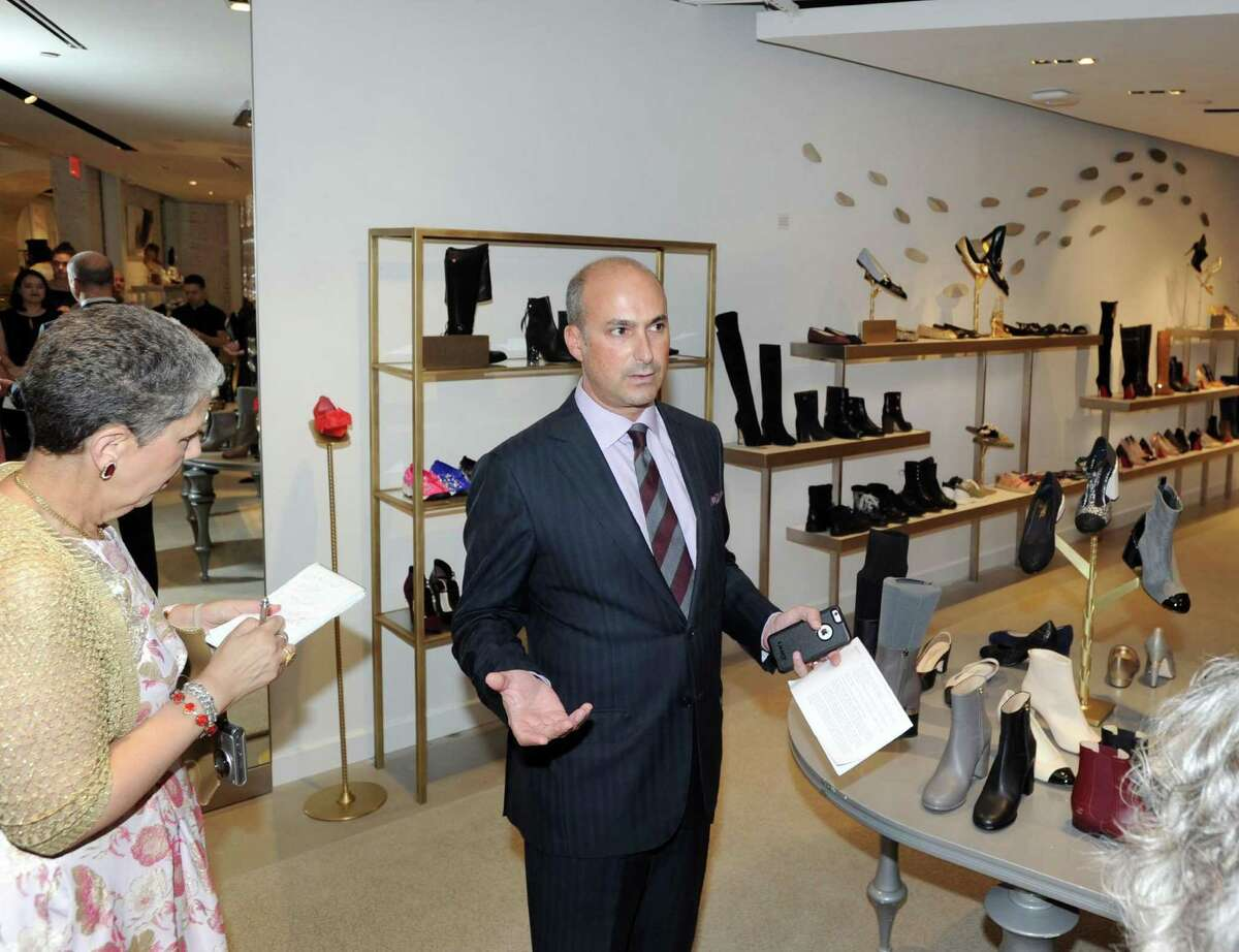 Joe Gambino, vice president and general manager of The Saks Shops at Greenwich, gives the preview tour of the new Saks Fifth Avenue standalone shoe store, 10022-Shoe Greenwich, the first of its kind for Saks, at 20 E. Elm St. in Greenwich on Wednesday.