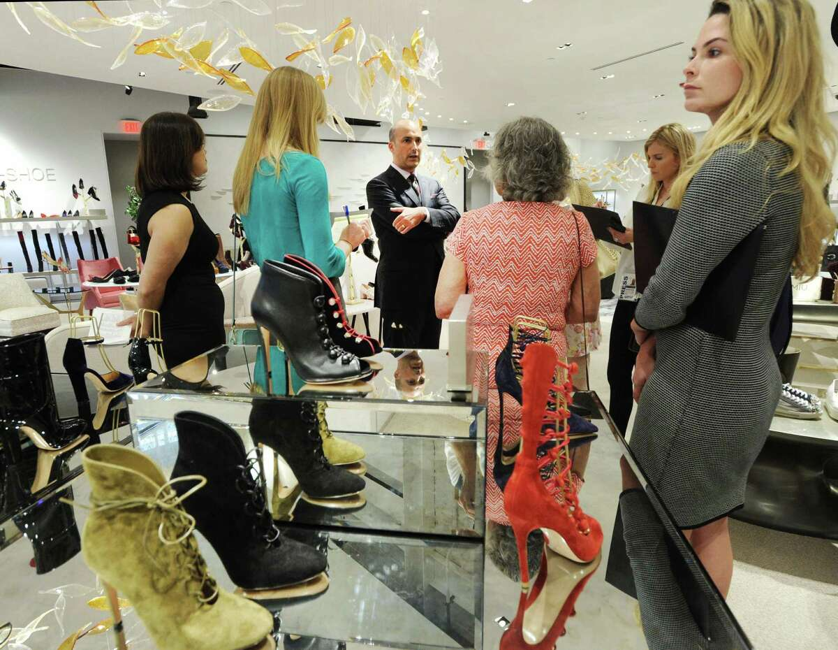 At center, Joe Gambino, vice president and general manager of The Saks Shops at Greenwich, gives the preview tour of the new Saks Fifth Avenue standalone shoe store, 10022-Shoe Greenwich.