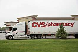 A truck sits parked outside of a CVS Health Corp. pharmacy in La Vista, Nebraska, U.S., on Saturday, April 30, 2016. CVS Health Corp. is scheduled to release earnings figures on May 3. Photographer: Daniel Acker/Bloomberg