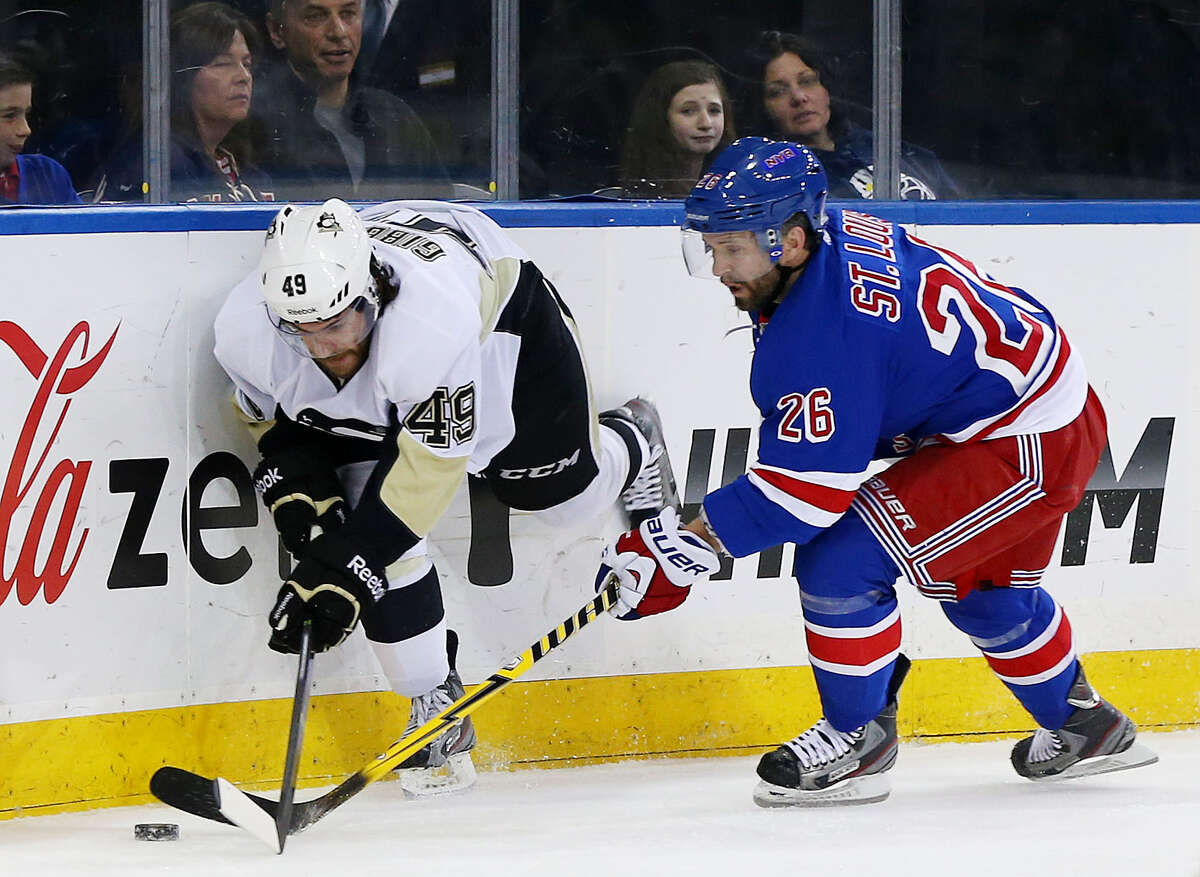 NEW YORK, NY - MAY 11: Brian Gibbons #49 of the Pittsburgh Penguins and Martin St. Louis #26 of the New York Rangers vies for the puck in the first period during Game Six of the Second Round of the 2014 NHL Stanley Cup Playoffs at Madison Square Garden on May 11, 2014 in New York City. (Photo by Elsa/Getty Images) ORG XMIT: 488087755 ORG XMIT: MER2016102011434066