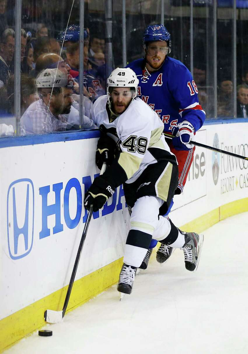 NEW YORK, NY - MAY 11: Brian Gibbons #49 of the Pittsburgh Penguins controls the puck against Marc Staal #18 of the New York Rangers in the third period during Game Six of the Second Round of the 2014 NHL Stanley Cup Playoffs at Madison Square Garden on May 11, 2014 in New York City. (Photo by Elsa/Getty Images) ORG XMIT: 488087755 ORG XMIT: MER2016102011432564