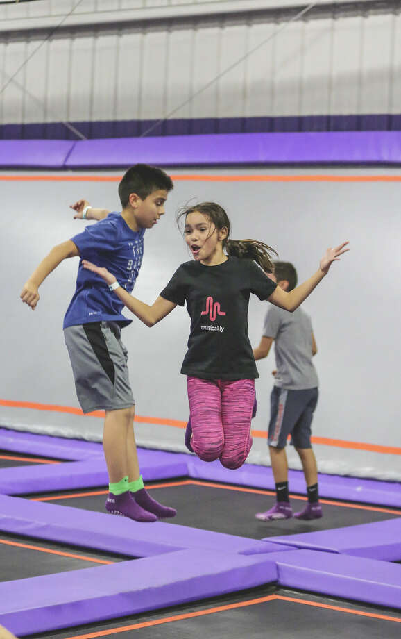 Children enjoy a jump session at Altitude Trampoline Park Laredo during the grand opening event on Thursday afternoon.