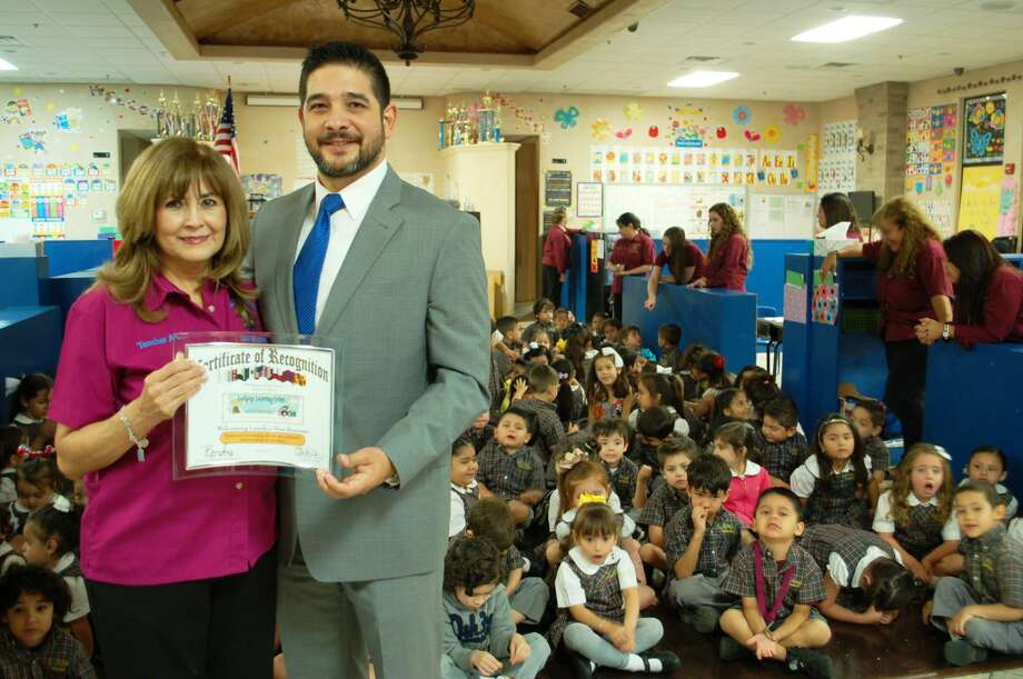 Laredo City Councilman poses with Annie Martinez, founded of Lollipop Learning Center.