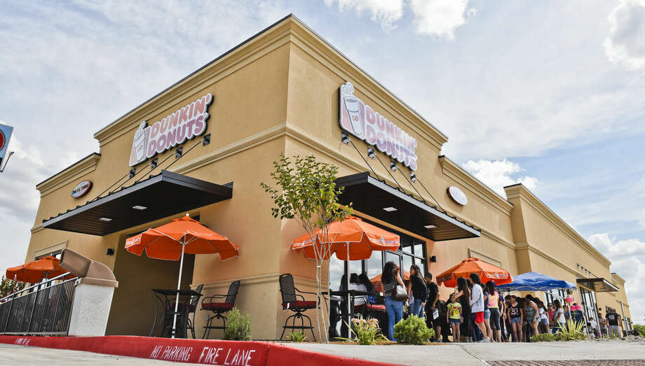 Laredoans form a line outside Dunkin' Donuts, 1201 E. Del Mar Blvd., on Tuesday afternoon as it opened its doors to the public for the first time.