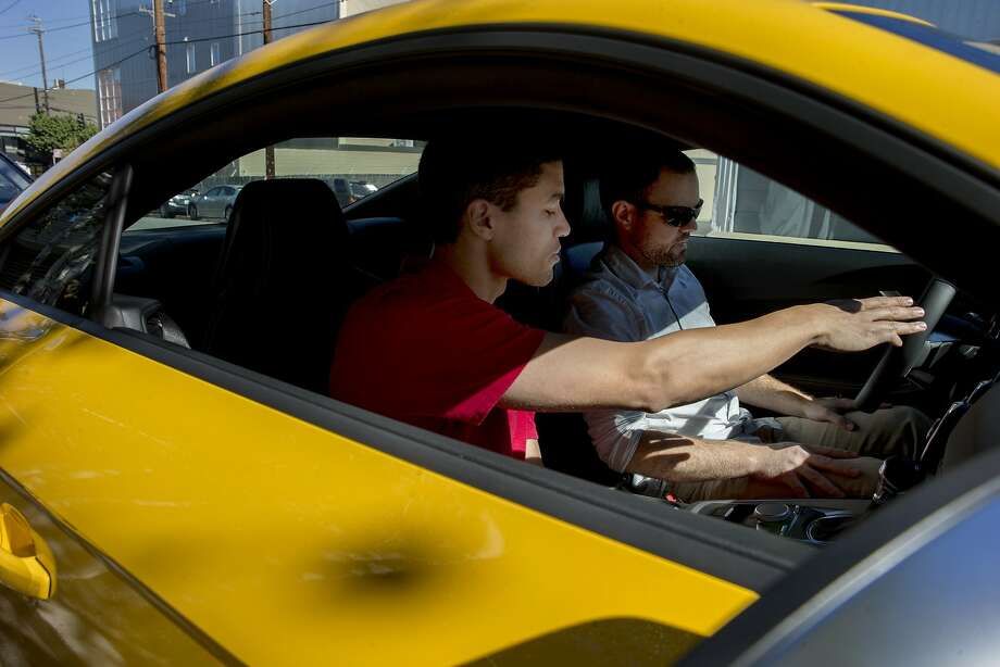 Audi concierge Talon Willard shows the Audi TTS Coupe features to Matt Sutter, who rented it for a date with his wife. Photo: Santiago Mejia, The Chronicle