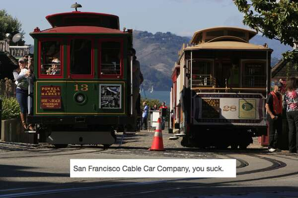 The Cable Car on the left is leaving Aquatic Park, fully loaded with people as the line of Cable Cars waits to be put into position to get turned around in San Francisco, Calif., on Saturday October 18, 2014. Daniel E. Porter	/SF Chronicle
