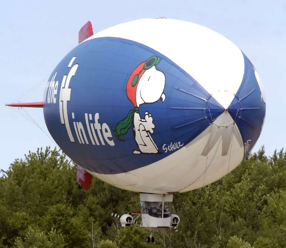 """Snoopy and his Sopwith Camel are grounded, at least when it comes to selling life insurance. MetLife called the decision the """"most significant change"""" to the brand in decades. Photo: Associated Press /File Photo / The Grand Rapids Press"""