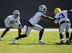Oakland Raider linebackers Perry Riley, 54 and Bruce Irvin, 51 run drills with Branden Jackson, 63  during practice in Alameda, California. on Thursday October 20, 2016.