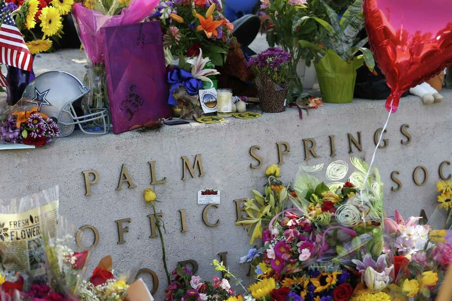 Mourners leave' flowers, cards, candles and notes and at a memorial for two Palm Springs, Calif., police officers slain on Oct. 6. A reader honors these and other fallen officers in her own way. Photo: Allen J. Schaben /TNS / Los Angeles Times