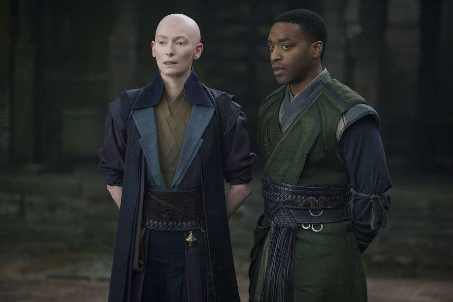 """Left photo: Tilda Swinton (left) as the Ancient One, and Chiwetel Ejiofor as Mordo, in Marvel's """"Doctor Strange."""" Above, Benedict Cumberbatch as Doctor Strange. Photo: Marvel"""