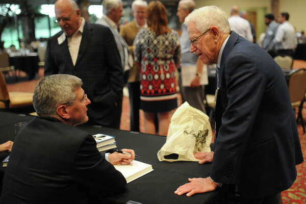 "Jin Henry of Henry Resources speaks with author Stephen Moore during a book signing and reception about the book titled ""Fueling Freedom: Exposing the Mad War on Energy,"" Wednesday, Oct. 20, 2016, at Green Tree Country Club.   James Durbin/Reporter-Telegram"