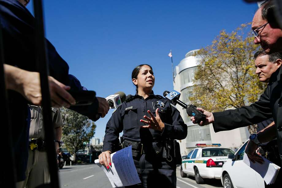 Officer Giselle Talkoff gives the media an update on the status of a potential bomb threat at 7th and Bryant Streets, in San Francisco, California, on Thursday, Oct. 20, 2016. Photo: Gabrielle Lurie, The Chronicle