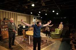 """Mark McCarver (center) stars in """"Tribes"""" in the Cellar Theater of The Playhouse San Antonio."""