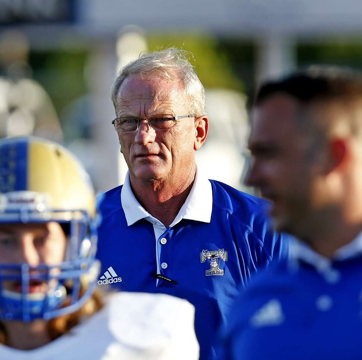 Kerville Tivy coach David Jones watches his team before a District 27-5A high school game against Alamo Heights on Sept. 23,2016.