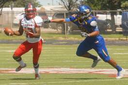Wayland Baptist University defensive end Jacob Hinojos, right, pressures the Sul Ross State quarterback during a game earlier this season. The Pioneers will be seeking their fifth consecutive victory Saturday when they take on Texas College in Tyler.