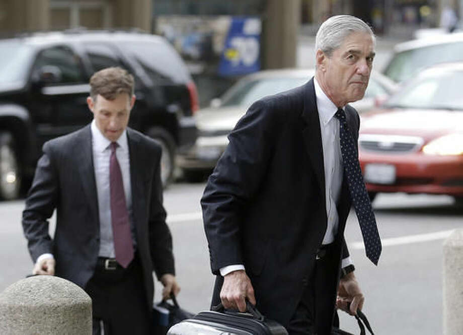FILE - In this April 21, 2016 file photo, attorney and former FBI Director Robert Mueller, right, arrives for a court hearing at the Phillip Burton Federal Building in San Francisco. Mueller has been overseeing settlement talks with Volkswagen, the U.S. government and private lawyers. Mueller is being honored with an award from West Point. The U.S. Military Academy's Association of Graduates will present the Thayer Award to Mueller on Thursday evening, Oct. 6, 2016. (AP Photo/Jeff Chiu, File)
