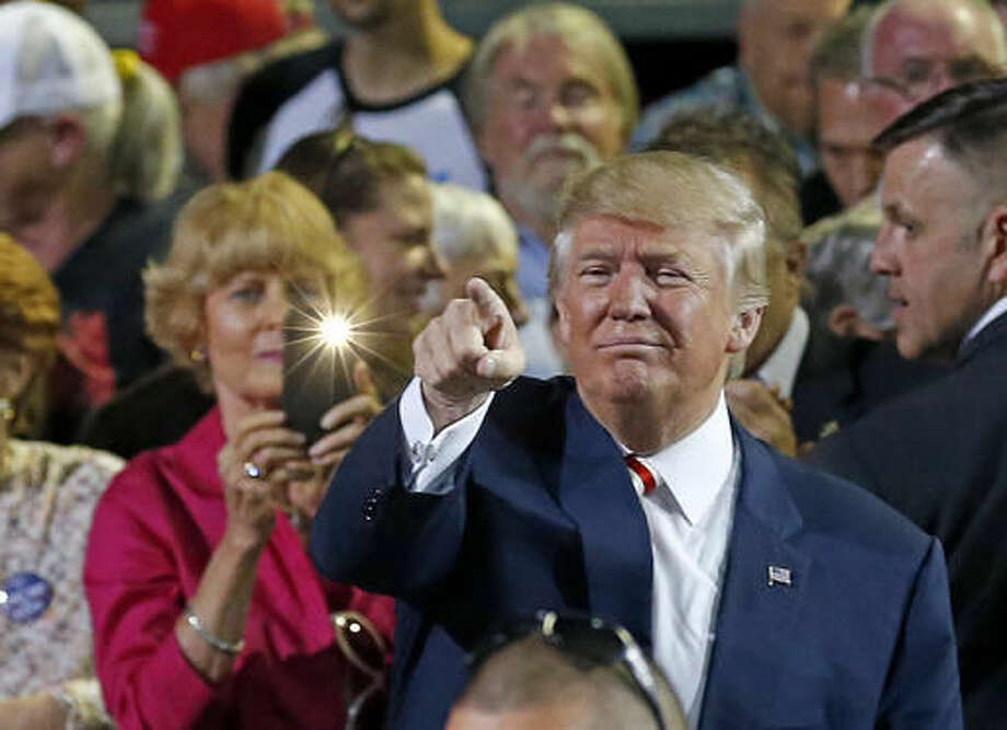 Republican presidential candidate Donald Trump points to supporters after speaking at a campaign rally Tuesday, Oct. 4, 2016, in Prescott Valley, Ariz. (AP Photo/Ross D. Franklin)