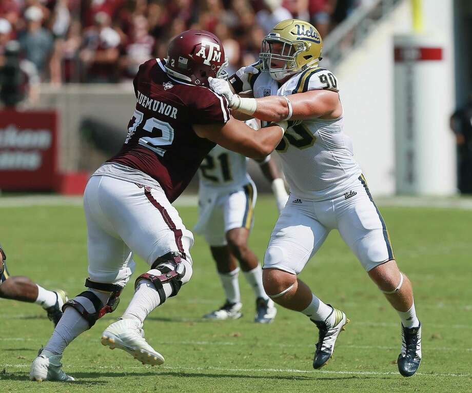 Jermaine Eluemunor (72) of the Texas A&M Aggies and Rick Wade of the UCLA Bruins lock up on a play at Kyle Field on Sept. 3, 2016 in College Station. Photo: Bob Levey /Getty Images / 2016 Getty Images