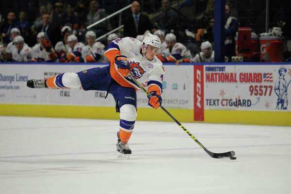 Matt Finn (42) of the Bridgeport Sound Tigers shoots during Game 1 of the 2016 Calder Cup Playoffs against the Toronto Marlies at Webster Bank Arena on April 23, 2016 in Bridgeport, Connecticut.