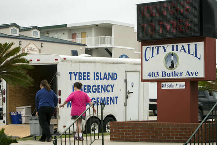 City of Tybee Island employees load an emergency management trailer during preparations for Hurricane Matthew, Wednesday, Oct. 5, 2016, on Tybee Island, Ga. (AP Photo/Stephen B. Morton)