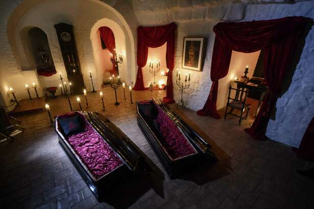 Two coffins are lit before a photo shoot in Bran Castle, in Bran, Romania. Airbnb has launched a contest to find two people to stay overnight in the castle on Halloween, popularly known as Dracula's castle because of its connection to the cruel real-life prince Vlad the Impaler, who inspired the legend of Dracula.