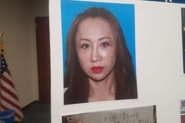 Spa owner Ying Wen, 43, was arrested at her home in north Houston on Thursday. Officers raided the Hana Top spa, Wen's house and an empty store front next to the spa.