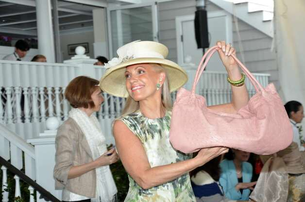 Alease Fisher Tallman Models A Devi Kroell Large Pink Ostrich Roman Bag Valued At 4 300