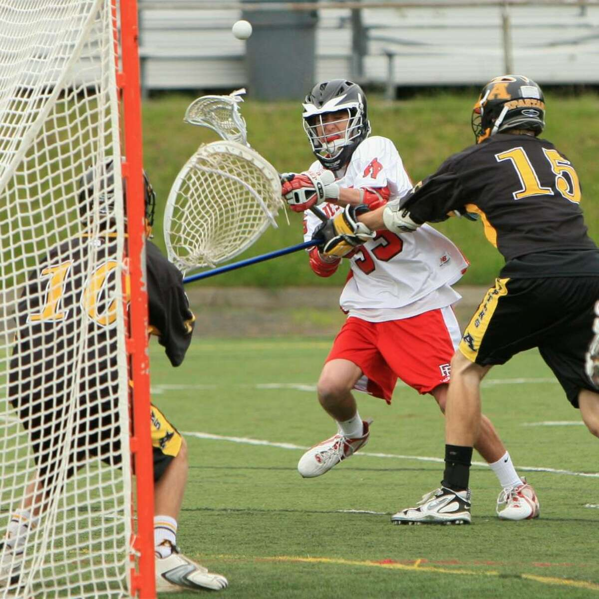 Fairfield Prep's Matt Mendencino tallies Fairfield Prep's 18th goal in the Jesuits' 19-4 win over Amity on Tuesday afternoon at Alumni Field. The goal was Medencino's first career varsity goal.