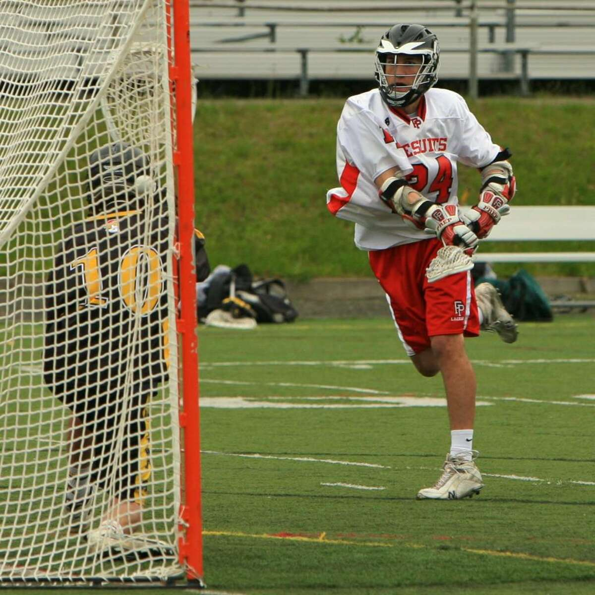 Fairfield Prep's Conner Byrne fires home his third goal of the afternoon in Prep's 19-4 win over Amity on Tuesday at Alumni Field.