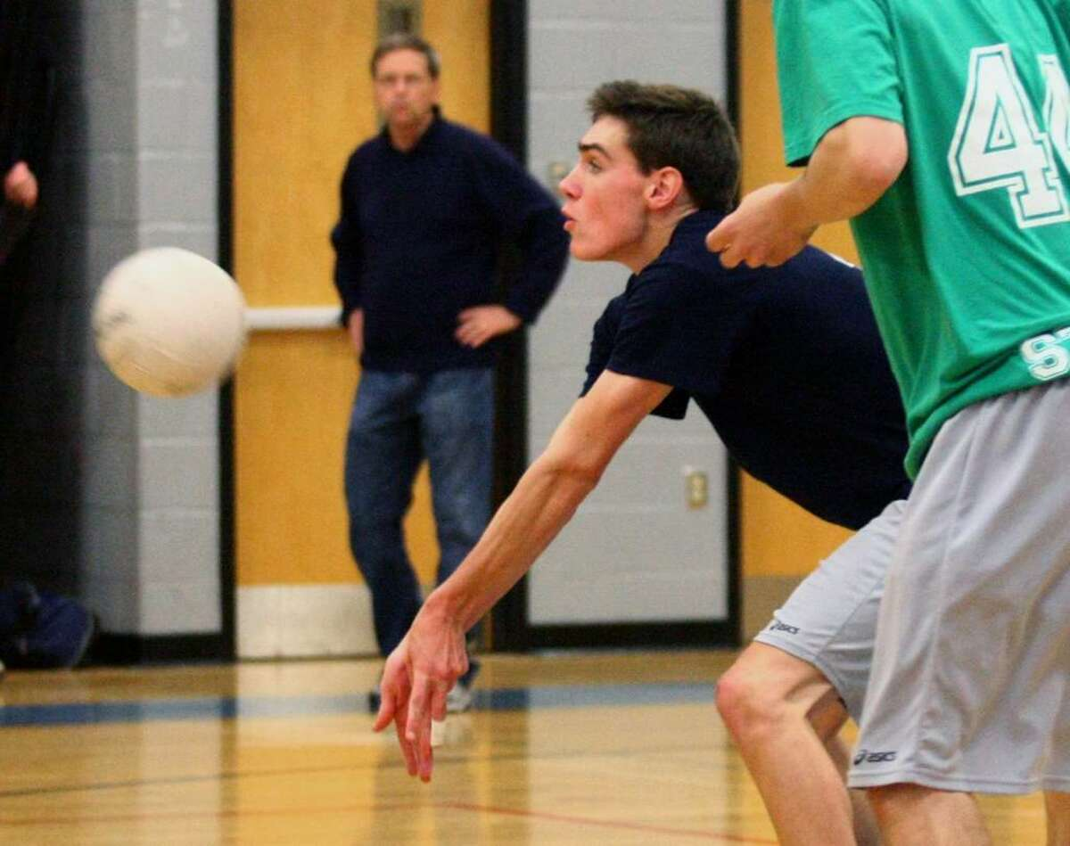 Staples' Tom Prenderville returns the ball, during volleyball action against Fairfield Ludlowe in Fairfield, Conn. on Wednesday May, 12, 2010.