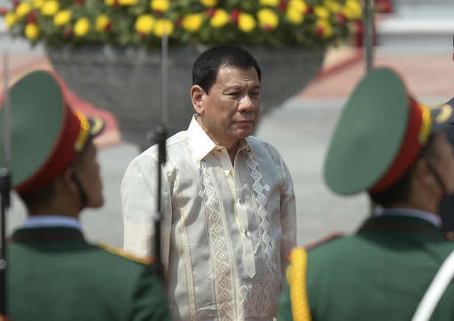 "FILE - In this Thursday, Sept. 29, 2016 file photo, Philippine President Rodrigo Duterte reviews an honor guard during a welcome ceremony at the Presidential Palace in Hanoi during his two-day visit to Vietnam. Israel's Foreign Ministry says it's ""unfortunate"" that Duterte chose to invoke Adolf Hitler and the Holocaust in his bloody anti-crime war. Spokesman Emmanuel Nahshon says Saturday, Oct. 1, Israel is convinced the Philippine president ""will find a way to clarify his words."" (Hoang Dinh Nam/Pool Photo via AP, File)"