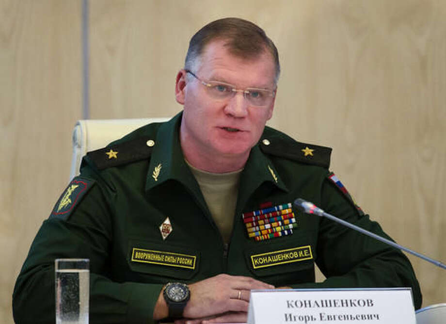 FILE In this Monday, Sept. 26, 2016 file photo Russian defense ministry spokesman Maj.-Gen. Igor Konashenkov speaks to the media in Moscow, Russia. Konashenkov strongly warned the United States against striking Syrian government forces and issued a thinly-veiled threat to use Russian air defense assets to protect them. (AP Photo/Ivan Sekretarev, file)