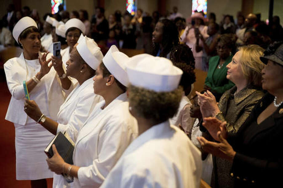 Democratic presidential candidate Hillary Clinton, second from right, stands in the audience during a service at the Little Rock AME Zion Church in Charlotte, N.C., Sunday, Oct. 2, 2016. (AP Photo/Andrew Harnik)