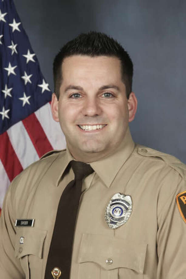 An undated photo provided by the St. Louis County Police Department shows St. Louis County Police officer Blake Snyder. Police say 33-year-old white officer Blake Snyder was fatally wounded during a pre-dawn shooting Thursday, Oct. 6, 2016, in Green Park, Mo., a small middle-class community. Police say the suspect, an 18-year-old white male, is in critical but stable condition after being shot by another officer. (St. Louis County Police Department via AP)