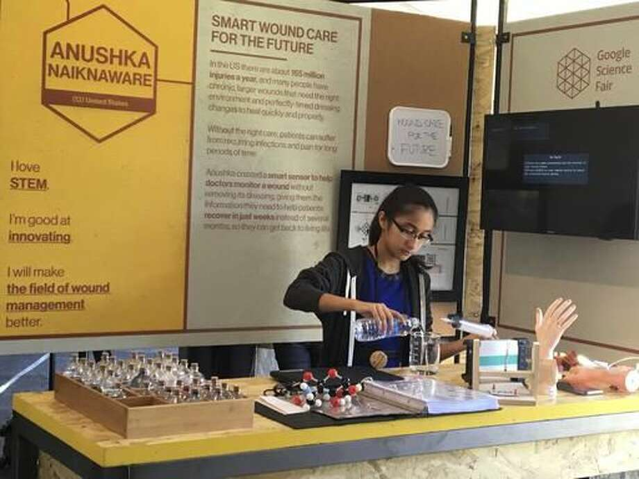 In this Sept. 25, 2016, photo supplied by Ravi Naiknaware, Anushka Naiknaware works on her project at the Google Science Fair in Mountain View, Calif. Naiknaware, 13, finished in the top eight in an international science contest run by Google, won a $15,000 scholarship, a free trip to the Lego world headquarters in Denmark and a year's worth of entrepreneurship mentoring from a Lego executive. (Ravi Kaiknaware via AP)