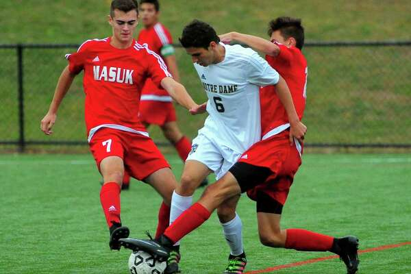 Notre Dame of Fairfield's Max Cano, center, gets tangled up with Masuk's Ryan Hodska, right, and Max Murray during boys soccer action at Veterans Field in Bridgeport, Conn., on Thursday Oct. 20, 2016.