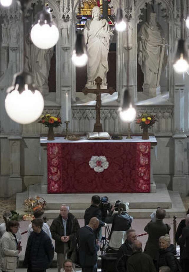 An embroidering antependium (altar hanging), a gift of Denmark's Queen Margrethe II, is placed at the altar after the service in the 'Schlosskirche' (Castle Church) in Wittenberg, Germany, Sunday, Oct. 2, 2016. Together with German President Joachim Gauck, Queen Margrethe II opened the Castle Church after several years of restoration. Queen Margrethe II is in Germany for a one-day-visit. (AP Photo/Jens Meyer)