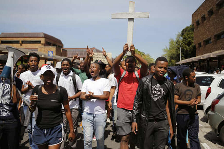 Students from the University of Cape Town attend a protest in Cape Town, South Africa, Tuesday, Oct. 4, 2016, demanding free university education. President Jacob Zuma has said the recent protests at some South African universities have caused about $44 million in property damage and threaten to sabotage the country's system of higher education. (AP Photo/Schalk van Zuydam)