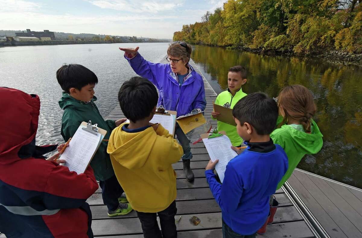 Rita Pickett leads a group of students in a discussion of water depth, currant and tide during Annual Hudson River Fact Finding Day Thursday Oct. 20, 2016 at the Hudson Shores Park in Watervliet, N.Y. (Skip Dickstein/Times Union)
