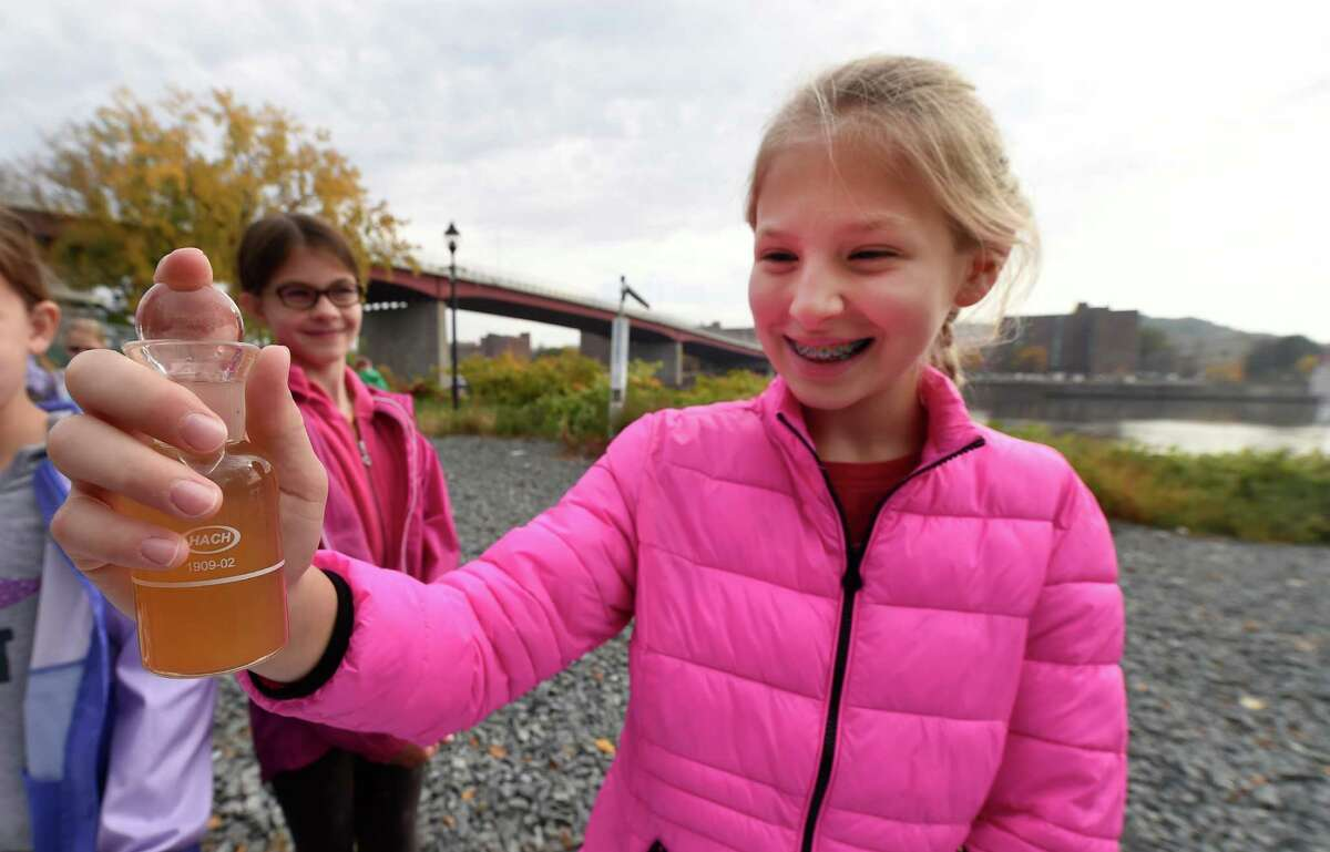 Fifth grader Olivia Gilbert, 10, shakes a bottle of river water to check the oxygen level during an experiment as part of the Annual Hudson River Fact Finding Day Thursday Oct. 20, 2016 at the Hudson Shores Park in Watervliet, N.Y. (Skip Dickstein/Times Union)