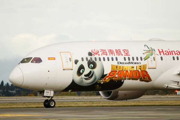 "Almost 100 high school students from Tacoma returned Tuesday from a visit to China aboard a new ""Kung Fu Panda""-themed Boeing 787. It was the first time the plane, one of 14 Boeing 787s that Hainan Airlines flies, had been seen in the U.S."
