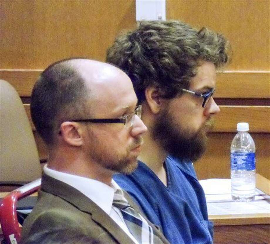 In this Friday, Sept. 30, 2016 photo, Christopher O'Kroley, right, appears in court, with his lawyer, Adam Welch, in Madison, Wis. O'Kroley will spend at least 40 years in prison for killing former grocery store co-worker Caroline Nosal in February, a Dane County judge decided at the hearing Friday. (Ed Treleven/Wisconsin State Journal via AP)