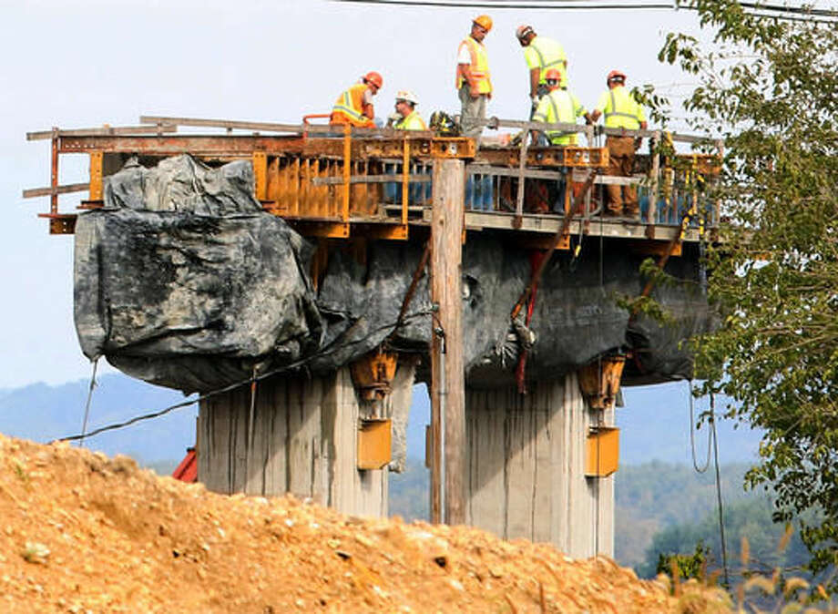 In this Sept. 13, 2016 photo, workers under North American General Contractors construct one of the piers for the new U.S. 52/IL 64 bridge project over the Mississippi River from Sabula, Iowa to Savanna, Ill. (Kevin Schmidt /Quad City Times via AP)
